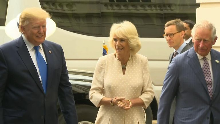 Prince Charles and Camilla have greeted Mr Trump ahead of tea at Clarence House.
