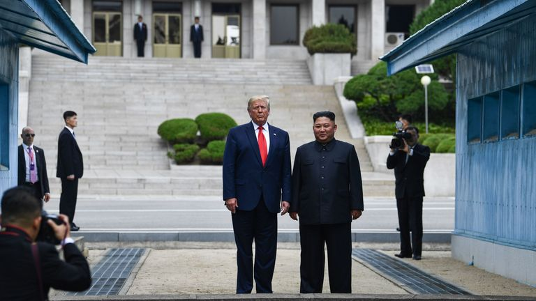 Donald Trump and Kim Jong Un stand at the military demarcation line dividing North and South Korea