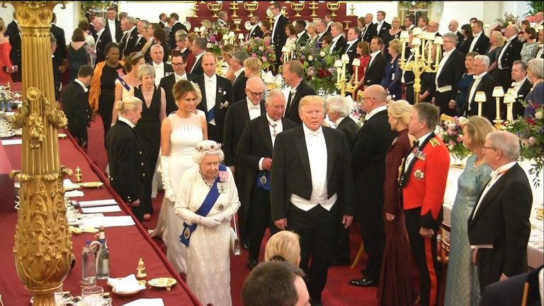 President Trump entered the banquet hall alongside the Queen.