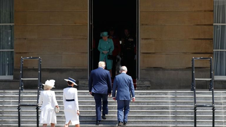 Prince Charles and Donald Trump head up the steps to meet the Queen