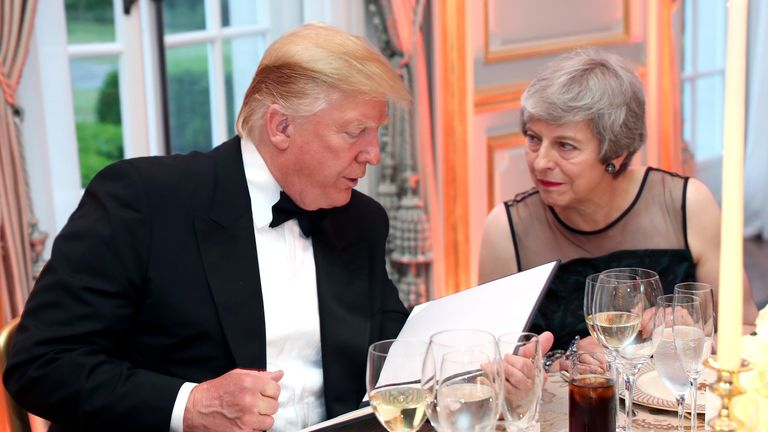 Donald Trump chats to Theresa May during dinner at Winfield House