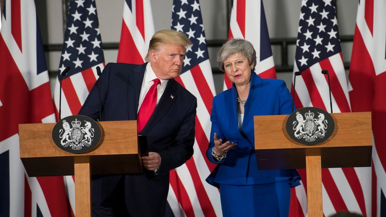 Theresa May calls Donald Trump 'go back' tweet 'completely unacceptable'