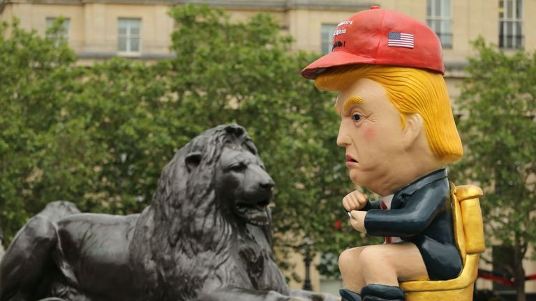 A 16ft statue of the US president on the toilet has been placed in Trafalgar Square