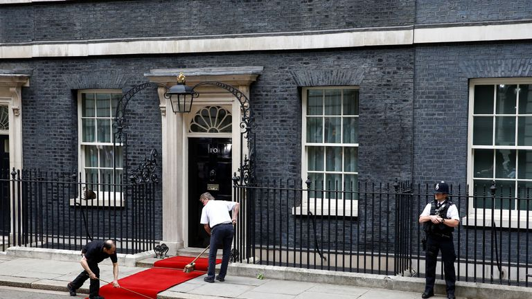 A red carpet is prepared at 10 Downing Street before Donald Trump arrives to meet Theresa May, as part of his state visit in London