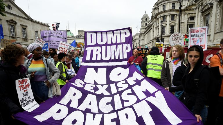 Demonstrators take part in a protest against Donald Trump, in London