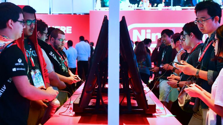 Gaming fans play Super Smash Bros on Nintendo Switch at the 24th Electronic Expo, or E3 2018, in Los Angeles, California on June 13, 2018 where hardware manufacturers, software developers and the video game industry present their new games at the 3-day event between June 12-14. (Photo by Frederic J. BROWN / AFP) (Photo credit should read FREDERIC J. BROWN/AFP/Getty Images)
