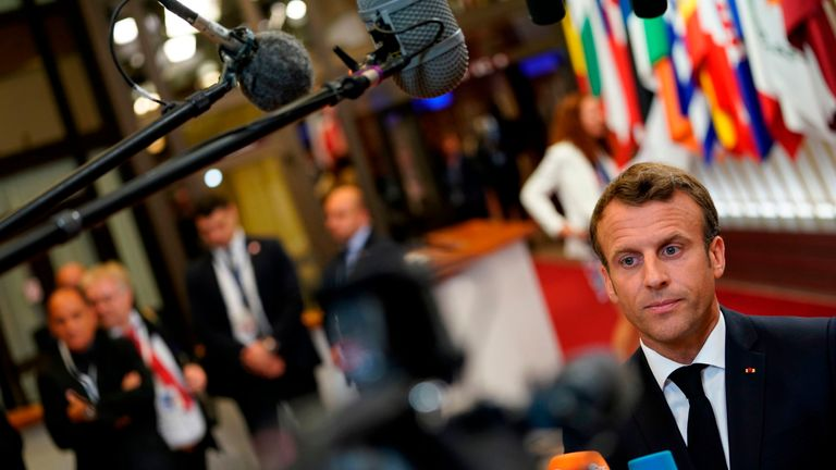 French President Emmanuel Macron speaks to the press as he leaves after a European Union (EU) summit at the EU Headquarters in Brussels on June 21, 2019 on the first day of a summit of EU leaders