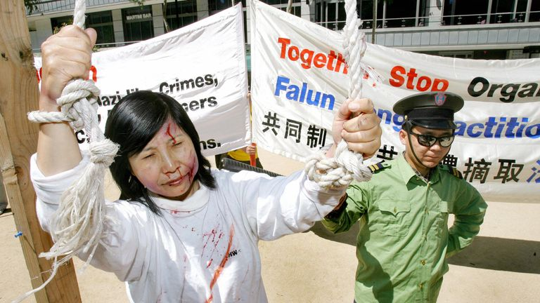 Falun Gong participate in street theatre in a protest over the Chinese government harvesting body organs from arrested Falun Gong practitioners in China as the world's biggest finance conference, the G20 summit, prepares to start, in Melbourne 17 November 2006