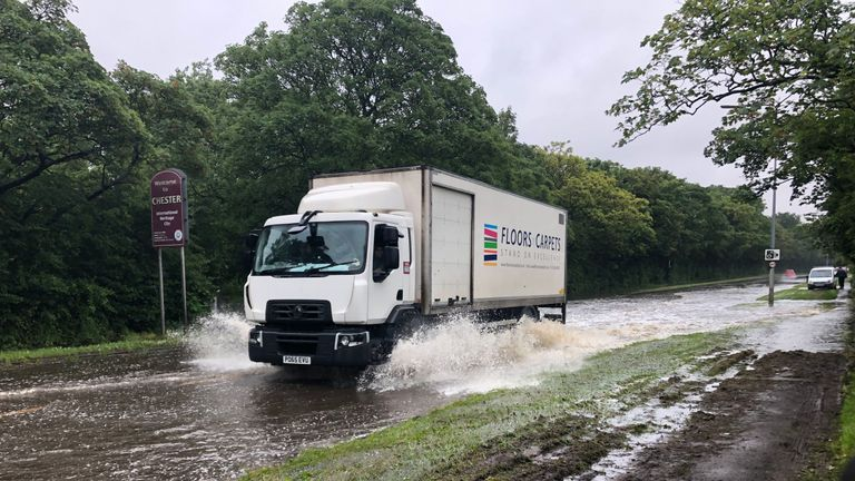 Floods begin to make driving difficult on Parkgate Road in Chester, as the Met Office has issued a yellow weather warning for parts of the north of England, Midlands, Scotland and Wales on Wednesday.