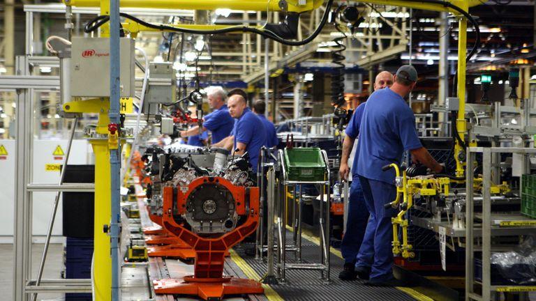 Engineers working on a Jaguar V8 engine at Ford's Bridgend plant