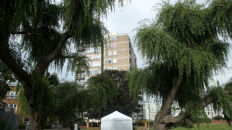 A forensic tent at the scene of the stabbing in Tower Hamlets