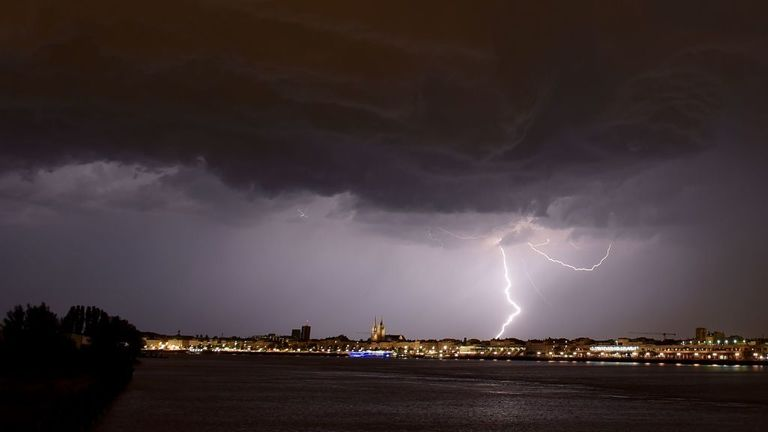Lightnings strike during a storm over Bordeaux, southwestern France, on June 18, 2019. (Photo by NICOLAS TUCAT / AFP) (Photo credit should read NICOLAS TUCAT/AFP/Getty Images)