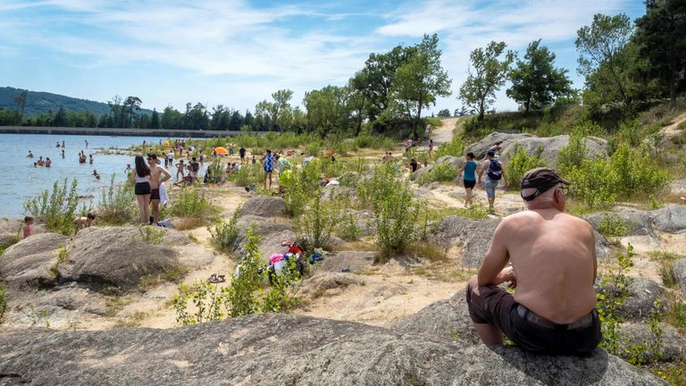 People cooled off on the banks of Saint-Ferreol at Revel, southwestern France at the weekend