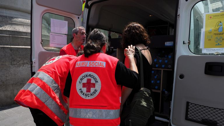 French Red Cross are handing out water to help people keep hydrated during the heatwave