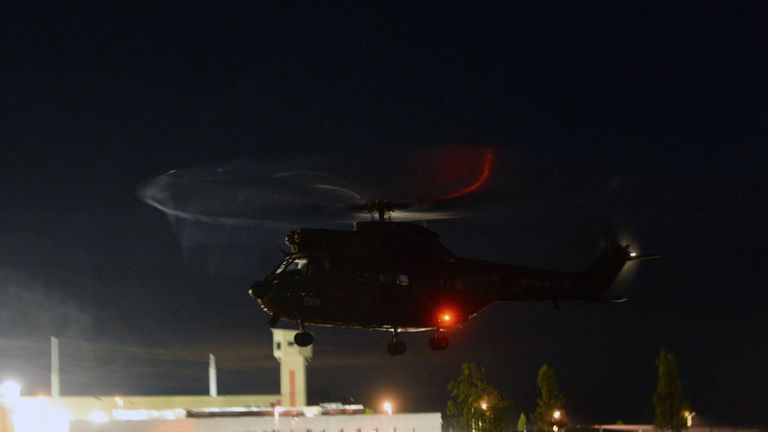 French army helicopters fly over with French police officers of the RAID at the penitentiary center of Alencon, in Conde-sur-Sarthe, northwestern France, as a hostage-taking is underway late on June 11, 2019. (Photo by JEAN-FRANCOIS MONIER / AFP) (Photo credit should read JEAN-FRANCOIS MONIER/AFP/Getty Images)