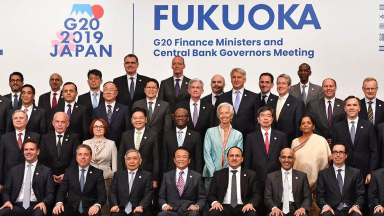 Japanese Finance Minister Taro Aso (front C) and Bank of Japan governor Haruhiko Kuroda (front 3rd L) pose with other delegation members during a family photo session at the G20 finance ministers and central bank governors meeting in Fukuoka on June 9, 2019. (Photo by TOSHIFUMI KITAMURA / AFP) (Photo credit should read TOSHIFUMI KITAMURA/AFP/Getty Images)