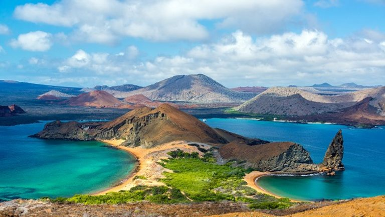 The trip includes exploring the Galapagos Islands and hiking mountain ranges in Australia