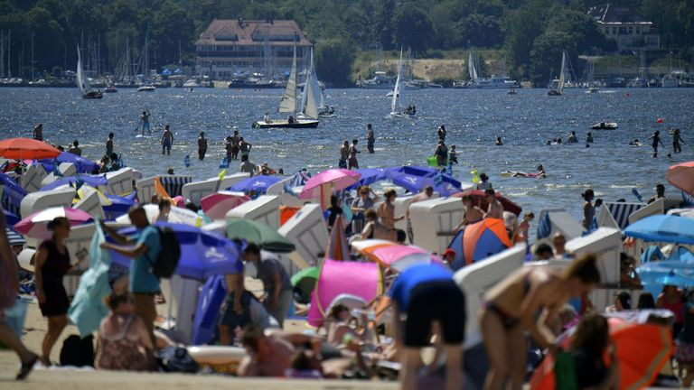 People packed public bathing beaches at lakes in Germany as temperatures peaked