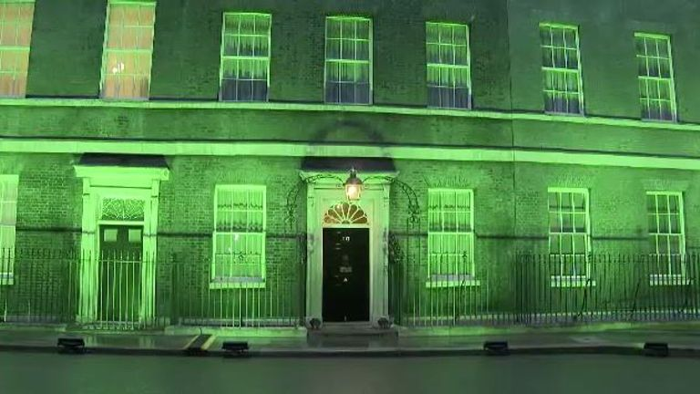 No 10 Downing Street is lit in green for Grenfell fire's second anniversary