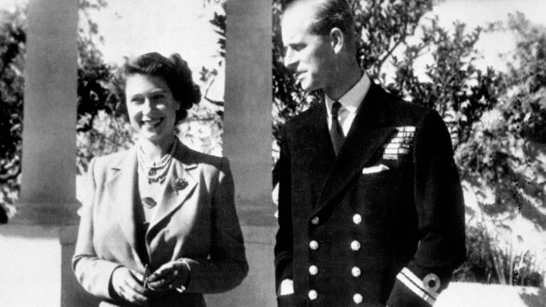Princess Elizabeth smiling happily as, with the Duke of Edinburgh, she enjoys the sunshine of Malta in the garden of the Villa Guardamangia in 1949