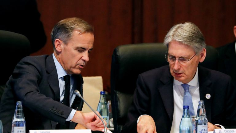 Bank of England Governor Mark Carney talks with British Chancellor of the Exchequer Philip Hammond