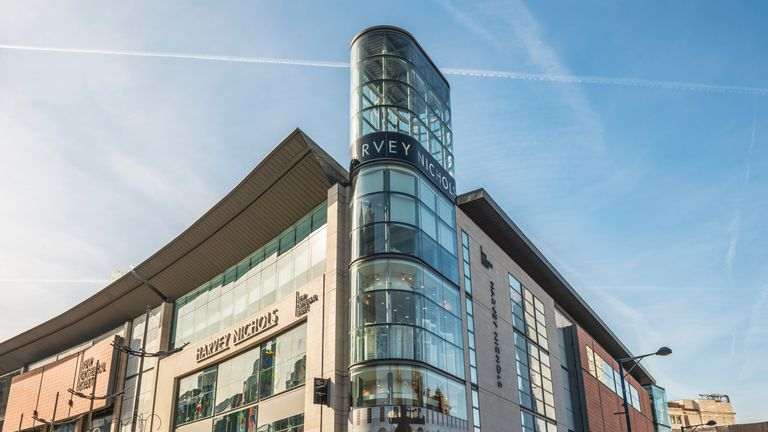 A woman was spotted in a window at Harvey Nichols, Manchester, allegedly trying to steal lingerie