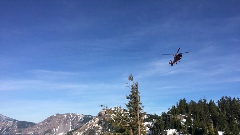 A helicopter arrived on the scene after the man fell into the crater. Pic: US Coast Guard Pacific Northwest