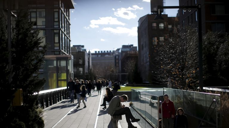 People enjoy mild temperatures along the The High Line park in New York