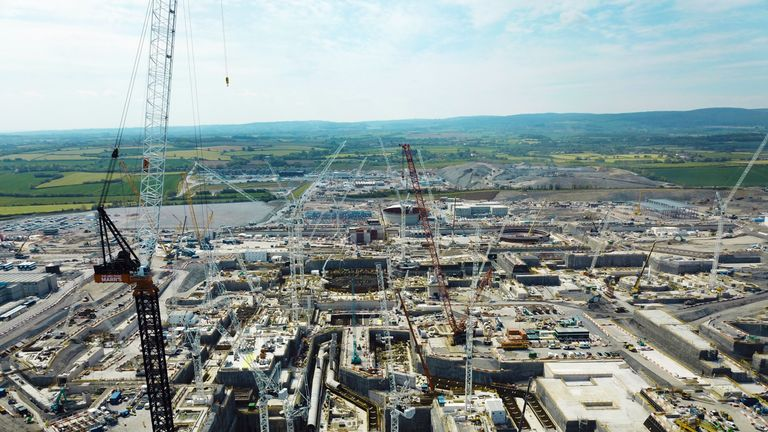 The view south across the Hinkley Point C site showing the main excavations and pipework for the cooling water systems of unit 1