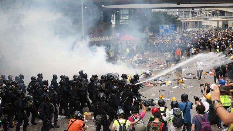 Police used tear gas, pepper spray and high-pressure water hoses against protesters. Pic: Kyra Campbell