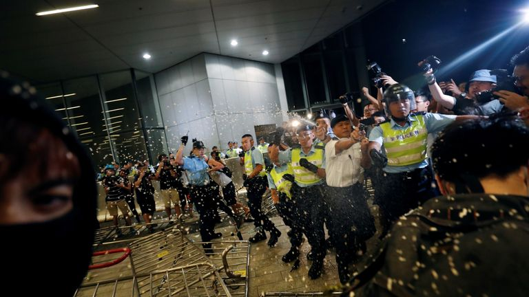 Police use pepper spray to disperse protesters calling for a block to a planned extradition law