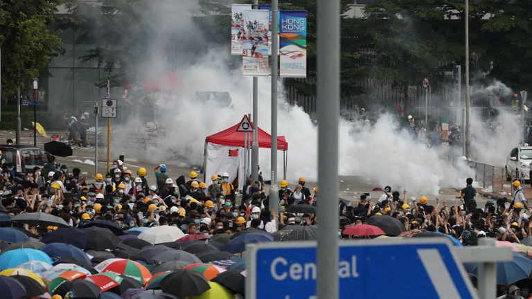 Police fire tear gas at protesters during a demonstration against a proposed extradition bill in Hong Kong