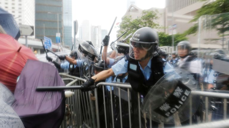 Protesters clash with riot police during a demonstration against a proposed extradition bill in Hong Kong