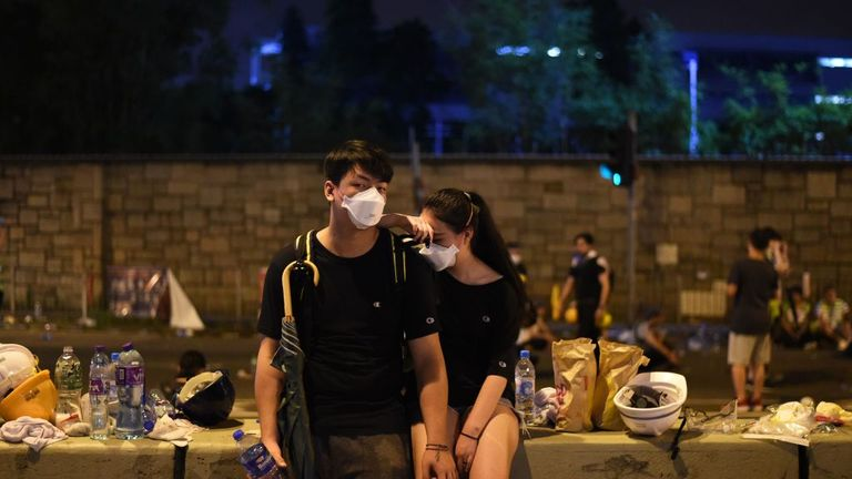 TOPSHOT - Demonstrators take a rest the night after a protest against a controversial extradition law proposal in Hong Kong on June 12, 2019. - Violent clashes broke out in Hong Kong on June 12 as police tried to stop protesters storming the city's parliament, while tens of thousands of people blocked key arteries in a show of strength against government plans to allow extraditions to China. (Photo by HECTOR RETAMAL / AFP) (Photo credit should read HECTOR RETAMAL/AFP/Getty Images)