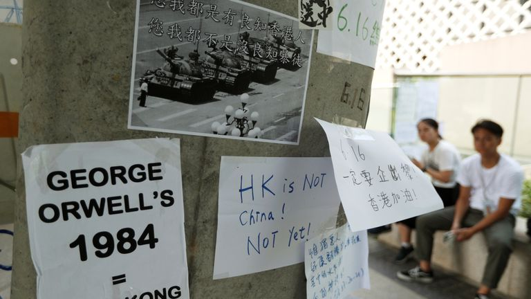 "A placard showing a 1989 photo of ""Tank Man"" from Tiananmen Square"