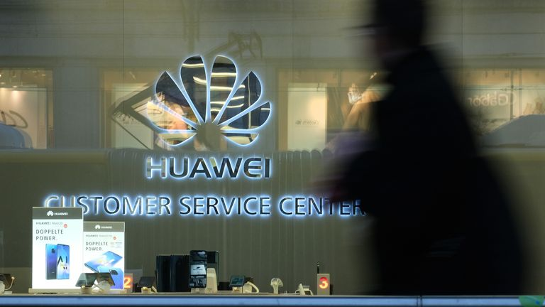 BERLIN, GERMANY - MARCH 12: A man walks past a Huawei customer service center on March 12, 2019 in Berlin, Germany. The U.S. government has warned Germany not to consider Huawei for the construction of Germany's new 5G mobile data network due to security fears. U.S. Ambassador Richard Grenell told the Germans that the U.S. would reconsider its sharing of intelligence with Germany if any Chinese companies supplied hardware for the German 5G network. (Photo by Sean Gallup/Getty Images)