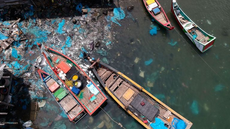 This aerial picture shows plastic waste filling the seabed of a coastal fishing village in Lhokseumawe, Aceh province
