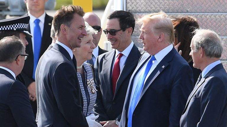 Donald Trump speaks with the Foreign Secretary Jeremy Hunt on the runway