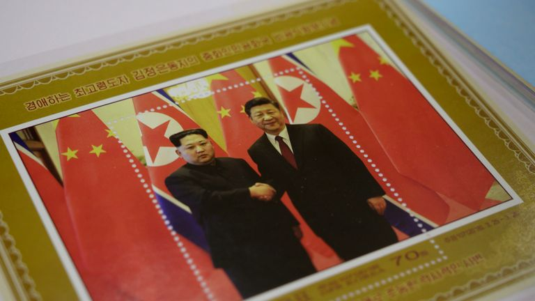 A commemorative stamp featuring North Korean leader Kim Jong-Un (L) meeting with China's leader Xi Jinping is pictured at a shop in Pyongyang on June 18, 2019