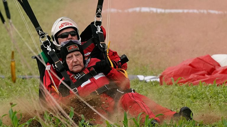 SANNERVILLE, FRANCE - JUNE 05: D-Day veteran Jock Hutton, aged 95, comes into land as he tandem jumped with the Red Devils of the Royal Parachute Regiment in a parachute drop onto fields at Sannerville on June 05, 2019 at Sannerville, France. Veterans, families, visitors and military personnel are gathering in Normandy on June 6th to commemorate the 75th anniversary of the Normandy Landings which heralded the Allied advance towards Germany and victory in Europe 11 months later. (Photo by Christo