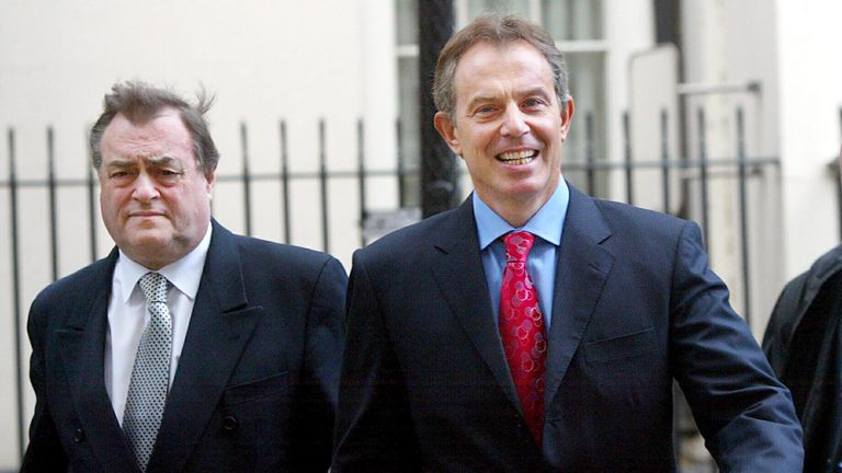Former deputy PM John Prescott (L) walks with former British PM Tony Blair on Downing Street in 2004