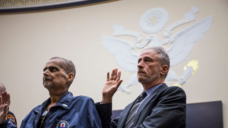 WASHINGTON, DC - JUNE 11: Retired New York Police Department detective and 9/11 responder Luis Alvarez, left, and Former Daily Show Host Jon Stewart, right are sworn in before testifying during a House Judiciary Committee hearing on reauthorization of the September 11th Victim Compensation Fund on Capitol Hill on June 11, 2019 in Washington, DC. The fund provides financial assistance to responders, victims and their families who require medical care related to health issues they suffered in the