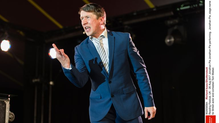 Tom Walker performs as satirical reporter Jonathan Pie