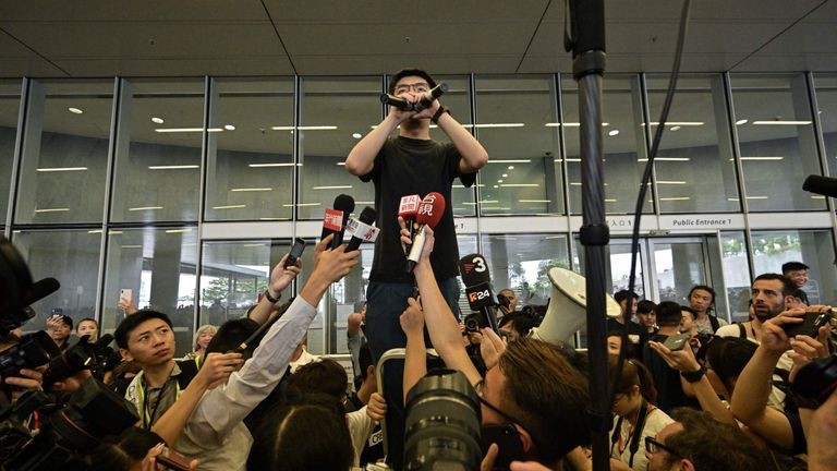 Joshua Wong speaks to protesters after being released from prison