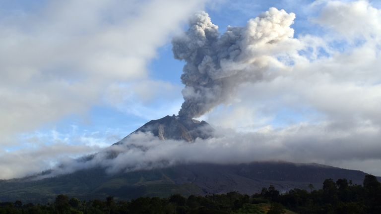 Mount Sinabung volcano spewing thick volcanic ash, as seen from Karo.