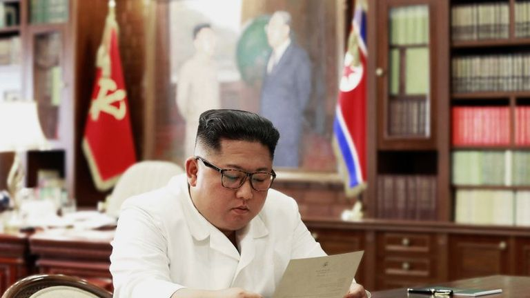 Kim Jong-Un regards the letter sent from Donald Trump. Pic: Korean Central News Agency