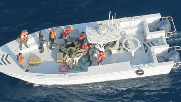 what the Pentagon says are members of the Islamic Revolutionary Guard Corps Navy photographed from a U.S. Navy MH-60R helicopter after removing an unexploded limpet mine from the M/T Kokuka Courageous