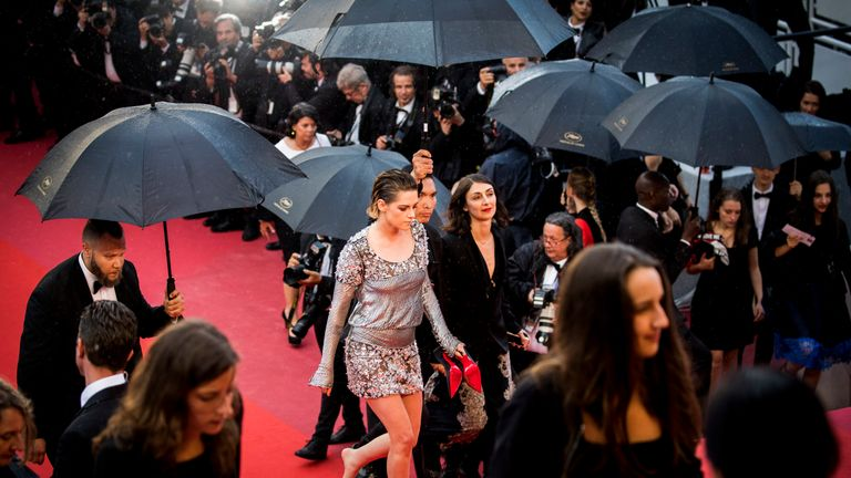 Kristen Stewart removed her heels as she walked the red carpet for the 2018 Cannes Film Festival