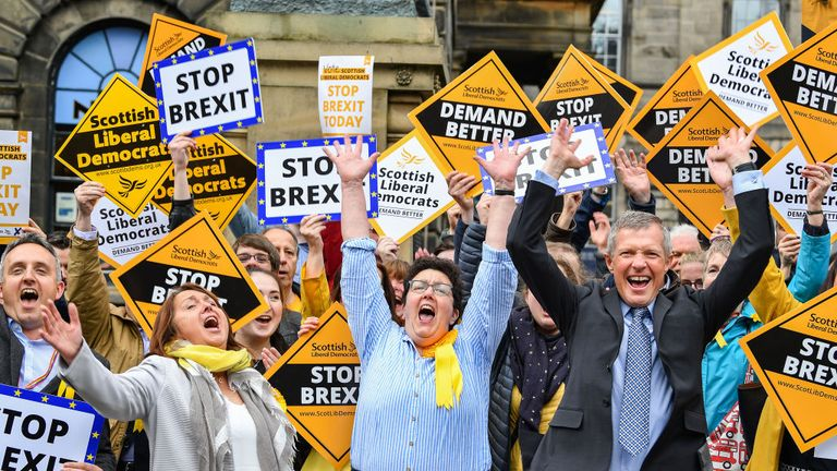 Newly elected European Parliament candidate Sheila Ritchie of the Liberal Democrats (C) is joined by leader Willie Rennie (R) after attending the declaration at the City Chambers on May 27, 2019 in Edinburgh, Scotland.