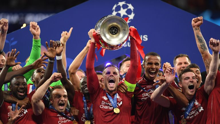 Liverpool captain Jordan Henderson lifts the cup